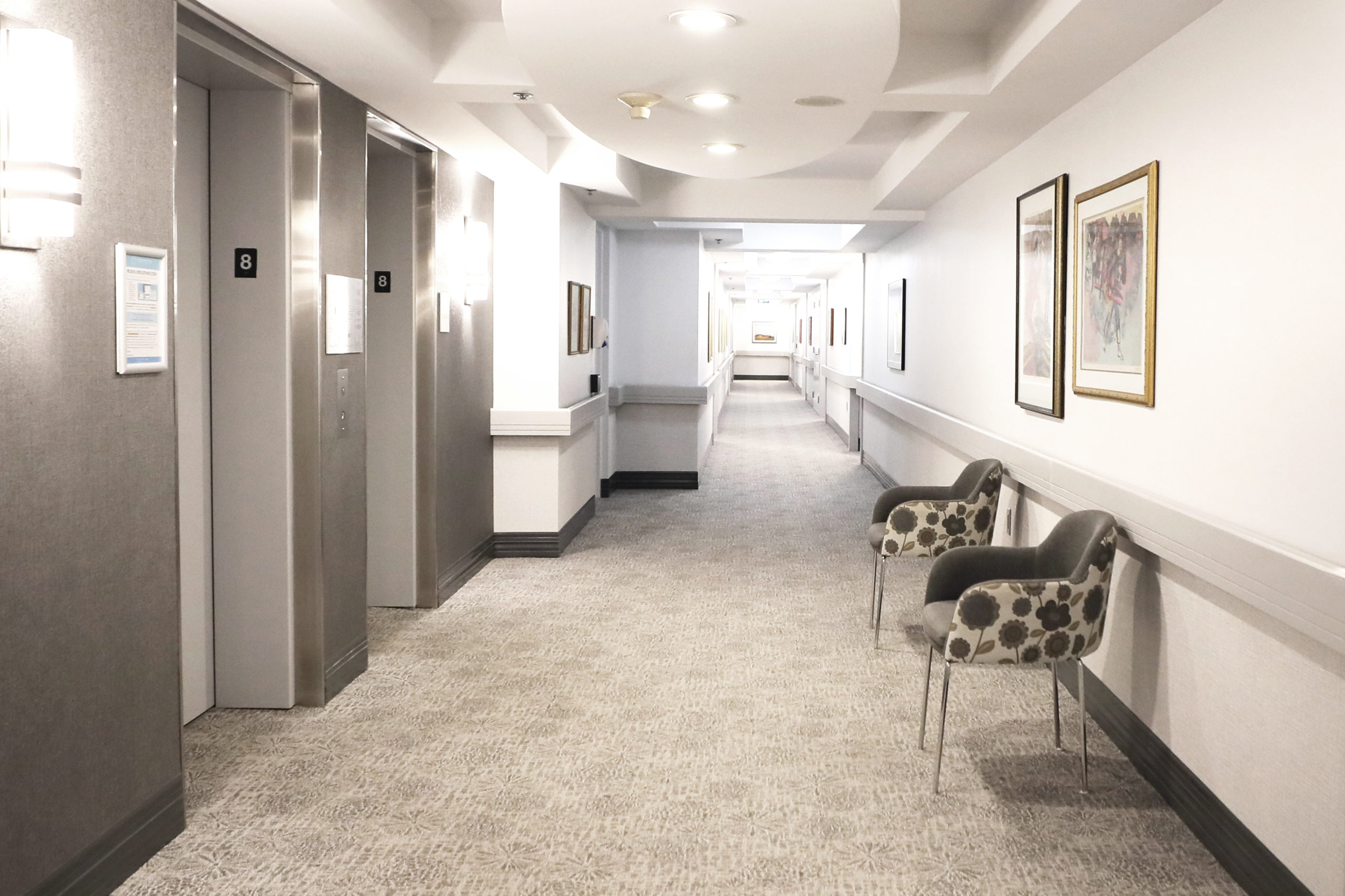 hallway with elevators
