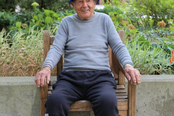 image 5 from hat parade - gentleman sitting in chair with white and blue hat