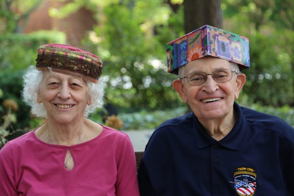 image 7 from hat parade - close up of couple with colourful hats