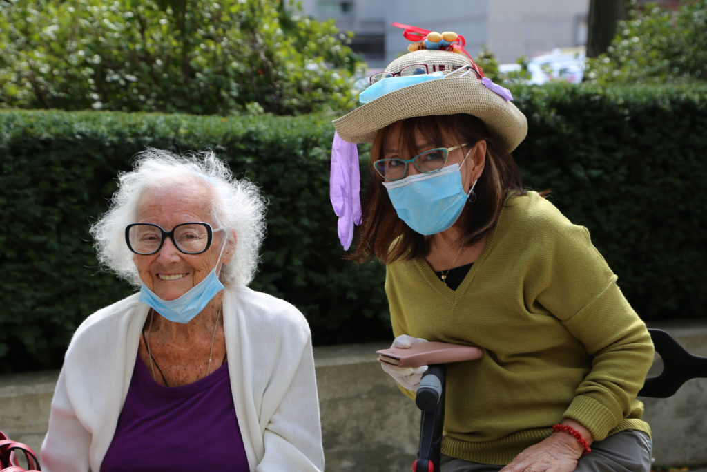 image 12 from hat parade - two ladies smiling into camera, one with colourful hat