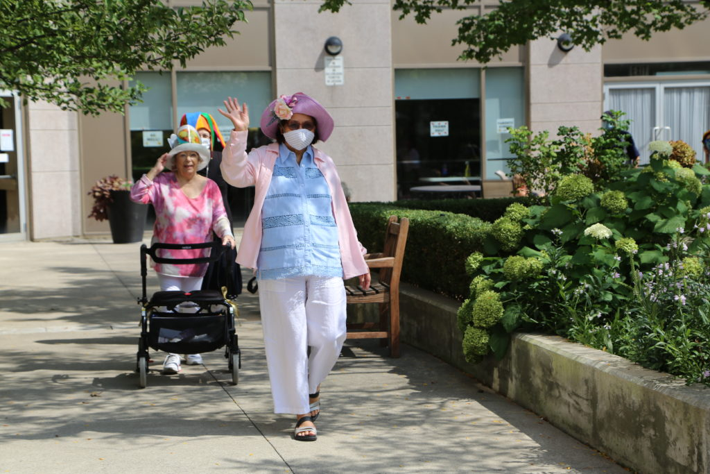 image 22 from hat parade - two ladies walking outside