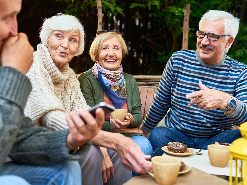 image of elderly group laughing together